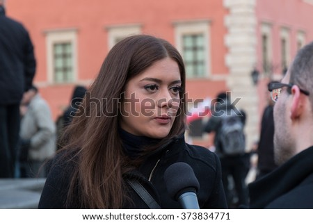 WARSAW, POLAND - FEBRUARY 06, 2016: Miriam Shaded, the President of Estera Fund, gives an interview during a demonstration against refugees in Warsaw, Poland. - stock photo