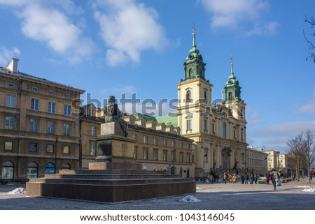 Warsaw, Poland - February 24, 2018: Monument of Nicolaus Copernicus and Holy Cross Church in Warsaw, Poland