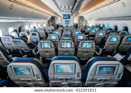WARSAW, POLAND - FEBRUARY 25, 2015. Passengers sits in Boeing 787 Dreamliner of LOT Polish Airlines before flying start in Warsaw - stock photo