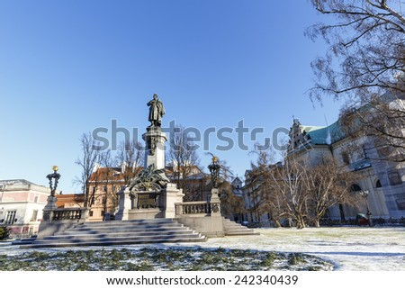 WARSAW, POLAND - JANUARY 06, 2015: Memorial to Adam Mickiewicz by Cyprian Godebski unveiled on December 24, 1898, removed in 1942 by the Germans, once again unveiled on January 28, 1950 - stock photo