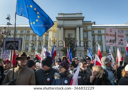 "WARSAW, POLAND - JANUARY 23, 2015: Supporters of democracy during a march organized by the Committee for the Defence of Democracy (KOD) entitled ""In defense of your freedom.""  - stock photo"
