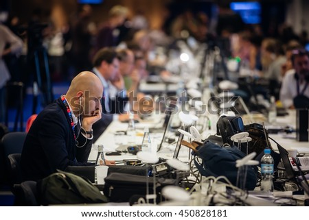 WARSAW, POLAND - Jul 9, 2016: North Atlantic Treaty Organization (NATO) summit in Warshaw, Poland. Working moments in the summit press center