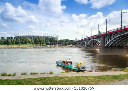WARSAW, POLAND - JUL 15: Polish National Stadium in Warsaw at the Vistula river, on July 15, 2013. Designed and built for UEFA EURO 2012 tournament is biggest soccer stadium in Poland. - stock photo