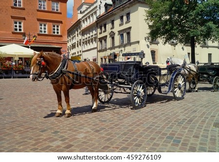 WARSAW, POLAND, 20,JULY 2016 ; Horse carriage at main square in Warsaw . Warsaw is the capital and the largest city of Poland