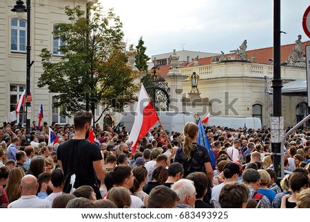 "Warsaw,Poland. 24 July 2017. Protesters rally in front of the presidential palace in Warsaw. Protesters hold posters reading ""constitution"" during a demonstration in front of the presidential palace."