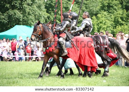 WARSAW, POLAND - JUNE 6: Knights on horseback during XV Knight Tournament on June 6, 2010 in Warsaw, Poland.