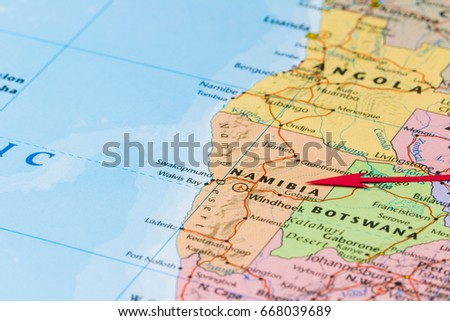 WARSAW, POLAND - JUNE 16, 2017: Photo of Namibia. Country indicated by red arrow. Country on African continent.
