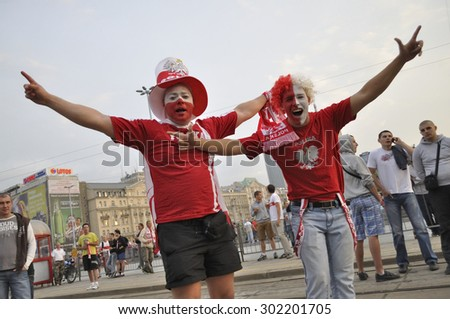 WARSAW, POLAND - JUNE 12, 2012 - Poland fans at the Warsaw street during the UEFA EURO 2012 Group A match against Russia. - stock photo