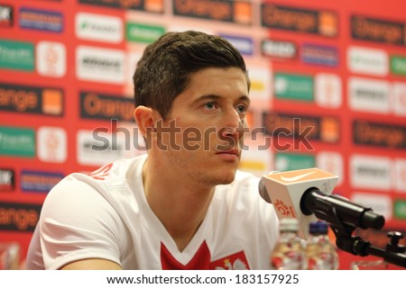 WARSAW, POLAND - MARCH 4: Robert Lewandowski, player of the Poland national football team attends a press conference before friendly match of Poland vs. Scotland on March 5, 2014 in Warsaw, Poland.  - stock photo