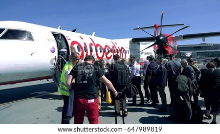 WARSAW, POLAND - MAY, 18, 2017. Air Berlin propeller plane boarding at the airport