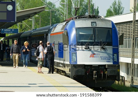 WARSAW, POLAND - MAY 1: Express train pulled by Siemens EuroSprinter locomotive on May 1, 2014 at Warsaw East rail station, Poland. Train is owned by PKP Intercity, the Polish largest railway operator - stock photo