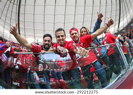 WARSAW, POLAND - MAY 27, 2015: FC Sevilla team supporters show their support during UEFA Europa League Final game against Dnipro at Warsaw National Stadium - stock photo