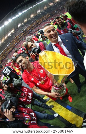 WARSAW, POLAND - MAY 27, 2015: Jose Antonio Reyes of FC Sevilla celebrates after winning UEFA Europa League Trophy after the game against FC Dnipro at Warsaw National Stadium - stock photo