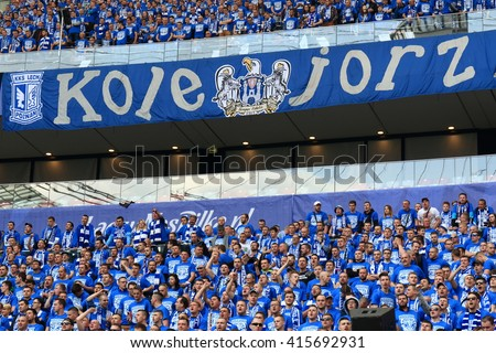 WARSAW, POLAND - MAY 2, 2016: Lech Poznan fanatical fans during Polish Cup final football match between Legia Warszawa and Lech Poznan at the National Stadium in Warsaw. Legia - Lech 1:0 - stock photo