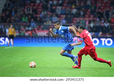 WARSAW, POLAND - MAY 27, 2015: Leo Matos of FC Dnipro (L) fights for a ball with Jose Antonio Reyes of FC Sevilla during their UEFA Europa League Final game at Warsaw National Stadium - stock photo