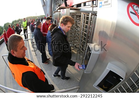 WARSAW, POLAND - MAY 27, 2015: People enter to the Warsaw National Stadium (Stadion Narodowy) before UEFA Europa League Final game between Dnipro and Sevilla - stock photo