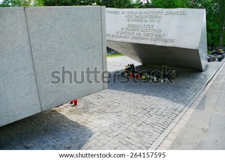 WARSAW, POLAND - MAY 6: Powazki Military Cemetery on May 6, 2014 in Warsaw, Poland. Monument commemorates 96 victims of Polish Governmental Tu-154 plane crash on April 10, 2010 in Smolensk, Russia. - stock photo