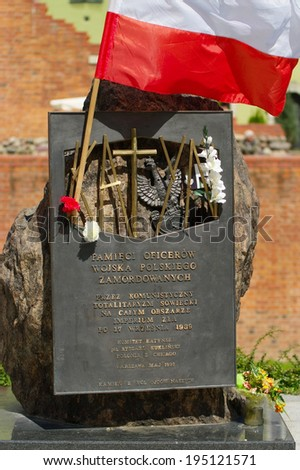 WARSAW, POLAND - MAY 5: The monument to the 22000 Polish army officers murdered in 1940 by Soviets in Katyn on May 5, 2014 in Warsaw, Poland. It is located in the Old Town on Podwale Street. - stock photo