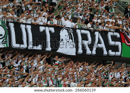 WARSAW, POLAND - MAY 31, 2015: Unidentified fans of Legia Warsaw during Polish League football match between Legia Warsaw and Wisla Krakow at the Pepsi Arena in Warsaw. - stock photo