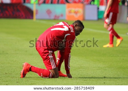 WARSAW, POLAND - MAY 31, 2015: Wilde Donald Guerrier, Haiti and Wisla Krakow defender during Polish League football match between Legia Warsaw and Wisla Krakow at the Pepsi Arena in Warsaw. - stock photo