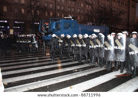 WARSAW, POLAND - NOVEMBER 11: The riots in the streets of Warsaw during the celebration of Independence Day on November 11, 2011 in Warsaw, Poland. - stock photo