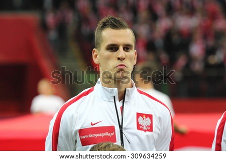 WARSAW, POLAND - OCTOBER 14, 2014: Arkadiusz Milik (Polish team and Ajax Amsterdam striker) before the UEFA EURO 2016 qualifying match of Poland vs. Scotland. - stock photo