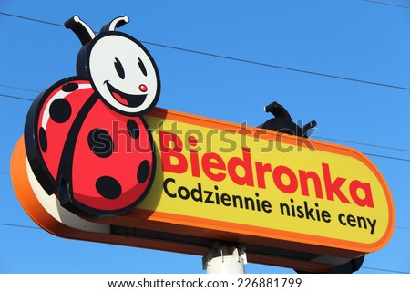 WARSAW, POLAND - OCTOBER 29, 2014: Biedronka sign. Biedronka is the biggest chain of no frills supermarkets in Poland (nearly 2,400 shops), owned by the Portuguese company Jeronimo Martins. - stock photo