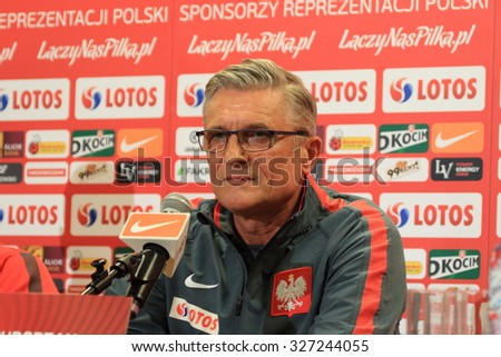 WARSAW, POLAND - OCTOBER 10, 2015: Coach Adam Nawalka (Poland) during press conference before EURO 2016 qualification football match beetween Poland and Republic of Ireland. - stock photo