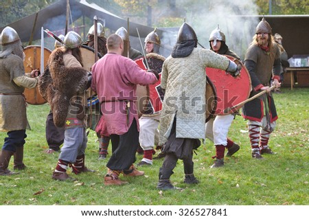 WARSAW, POLAND - OCTOBER 16, 2010: Fights and weapons show of ancient Slavic warriors - historical reenactment of the tenth century - Slavic Autumn in the Agrykola park.
