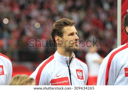 WARSAW, POLAND - OCTOBER 14, 2014: Grzegorz Krychowiak (Polish team and Spanish club Sevilla player) before the UEFA EURO 2016 qualifying match of Poland vs. Scotland. - stock photo