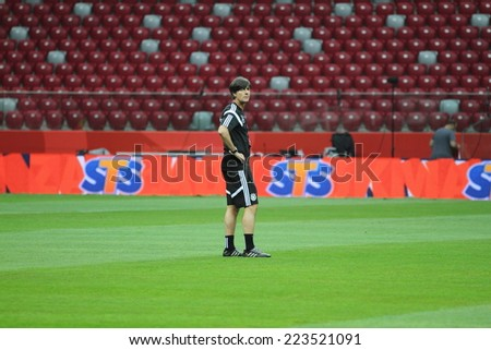 WARSAW, POLAND - OCTOBER 10, 2014: Joachim Loew, head coach of the German national football team at the last training session before the UEFA EURO 2016 qualifying match of Poland vs. Germany. - stock photo