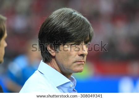 WARSAW, POLAND - OCTOBER 11, 2014: Joachim Low, head coach of the German national football team during the UEFA EURO 2016 qualifying match of Poland vs. Germany. Poland beat Germany 2:0 - stock photo