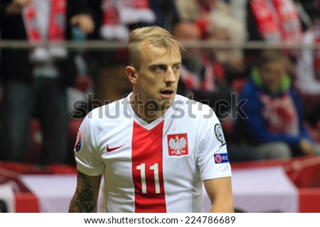 WARSAW, POLAND - OCTOBER 14, 2014: Kamil Grosicki (Polish team and French Ligue 1 club Stade Rennais player) during the UEFA EURO 2016 qualifying match of Poland vs. Scotland  - stock photo