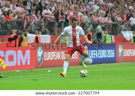 WARSAW, POLAND - OCTOBER 11, 2014: Maciej Rybus in action (Polish team and Russian Premier League club Terek Grozny player) during the UEFA EURO 2016 qualifying match of Poland vs. Germany - stock photo