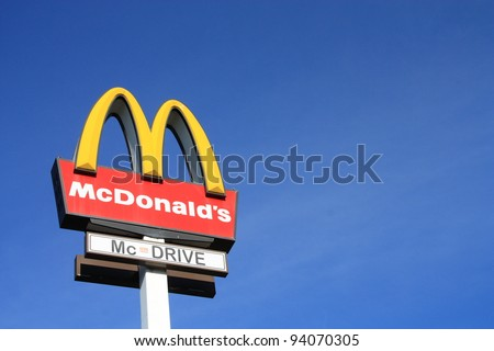 WARSAW, POLAND - OCTOBER 22: McDonalds logo on blue sky background on Oct.. 22, 2010 in Warsaw, Poland. McDonald's Corporation is the world's largest chain of hamburger fast food restaurants. - stock photo