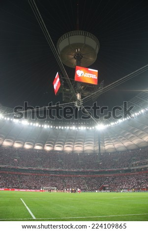WARSAW, POLAND - OCTOBER 11, 2014: National Stadium in Warsaw during the UEFA EURO 2016 qualifying match of Poland vs. Germany. Poland beat Germany 2:0. The match was watched by over 56,000 spectators - stock photo