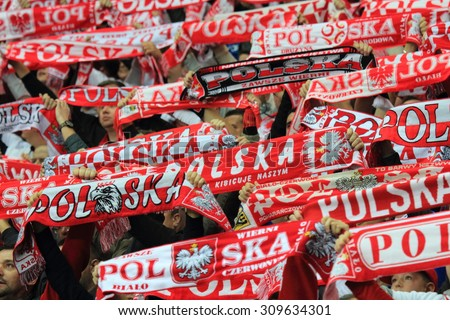 WARSAW, POLAND - OCTOBER 14, 2014: Polish football fans during the UEFA EURO 2016 qualifying match of Poland vs. Scotland. - stock photo
