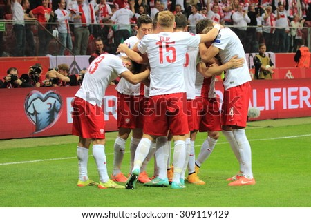 WARSAW, POLAND - OCTOBER 11, 2014: Polish players enjoy after scoring a goal during the UEFA EURO 2016 qualifying match of Poland vs. Germany. Final result: 2:0 for Poland - stock photo