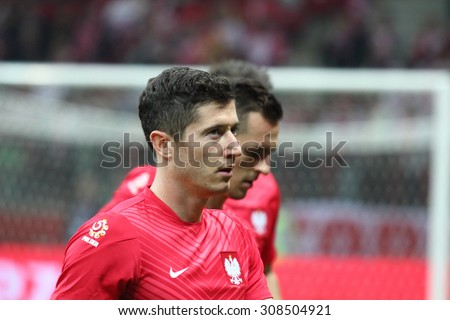 WARSAW, POLAND - OCTOBER 11, 2014: Robert Lewandowski (Polish team and Bundesliga club Bayern Munich striker) before the UEFA EURO 2016 qualifying match of Poland vs. Germany.  - stock photo