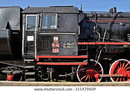 Warsaw, Poland - October 7, 2010: Steam locomotive Ty24 - manufactured in 1946 First Factory of Locomotives (PFL) in Poland - displayed at the rolling stock exhibition of the Railway Museum. - stock photo