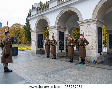 WARSAW, POLAND - OCTOBER 30, 2014: Tomb of the Unknown Soldier and the Honor Guard, since 1925. Part of the Saxon Palace at Pilsudski Square - stock photo
