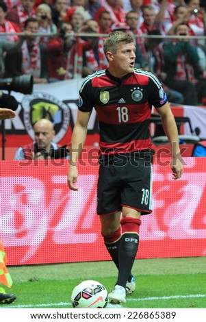 WARSAW, POLAND - OCTOBER 11, 2014: Toni Kroos in action (German team and Spanish club Real Madrid player) during the UEFA EURO 2016 qualifying match of Poland vs. Germany - stock photo