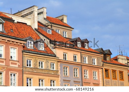 Warsaw, Poland. Old Town - tenements at the main square. UNESCO World Heritage Site. - stock photo
