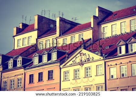 Warsaw, Poland. Old Town - tenements at the main square. UNESCO World Heritage Site. Cross processed color tone - retro filtered style. - stock photo