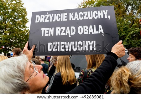 "Warsaw, Poland, 2016 10 01 - protest against anti-abortion law forced by Polish government; people with banner saying: ""quail KaczyÃ??ski, this government overthrow girls"""