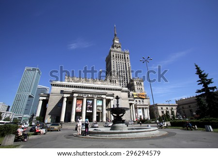 WARSAW, POLAND - SATURDAY, JUNE 6, 2015: A general view of the skyline of Warsaw, including the palace of culture, at right, and the museum of technology.   - stock photo