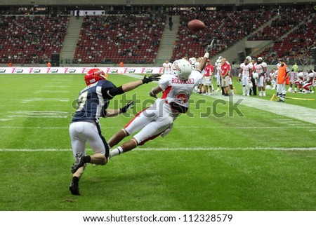 WARSAW, POLAND - SEPTEMBER 1: American football player, US team member Michael Rodriquez (TE/WR) tries to catch a football during Euro-American Challenge match on September 1, 2012 in Warsaw, Poland. - stock photo