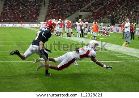 WARSAW, POLAND - SEPTEMBER 1: American football player, US team member Michael Rodriquez (TE/WR) falls down on the field during Euro-American Challenge match on September 1, 2012 in Warsaw, Poland.