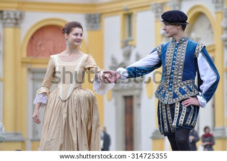 WARSAW, POLAND - SEPTEMBER 11, 2010: Ensemble Gratia Iuvenis shows the historical Court dances, during of the Wilanow Days event. - stock photo