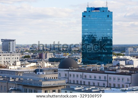WARSAW, POLAND - SEPTEMBER 30, 2015: Skyscraper towering over the city, it is a 22-storey office building, it was completed in 2001. The usable area of this building is 52200 square meters - stock photo